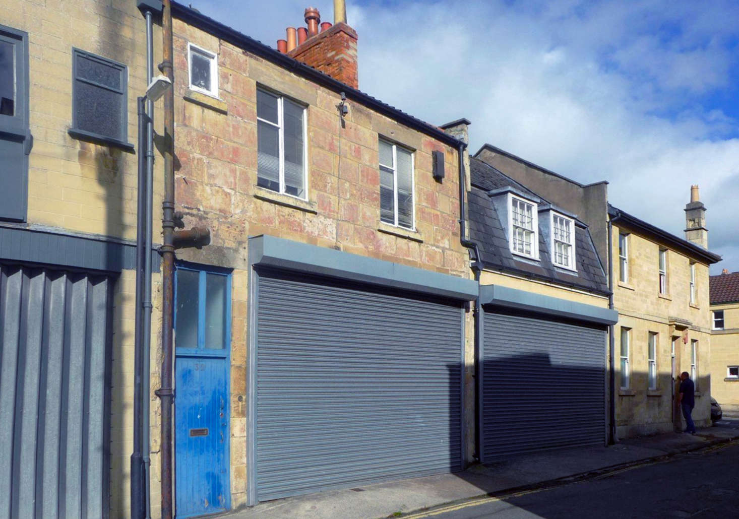 Located on Circus Place, the stone structure with the blue door had, like other buildings on the block, been converted into a garage in the 80s.