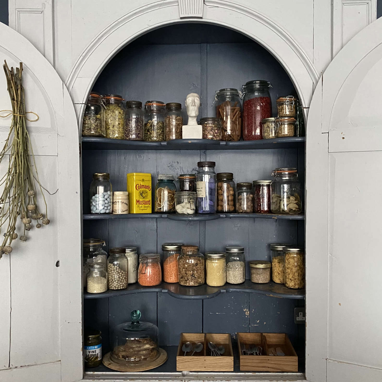 Another eBay purchase, an th century cupboard provides storage on the back wall of the kitchen.