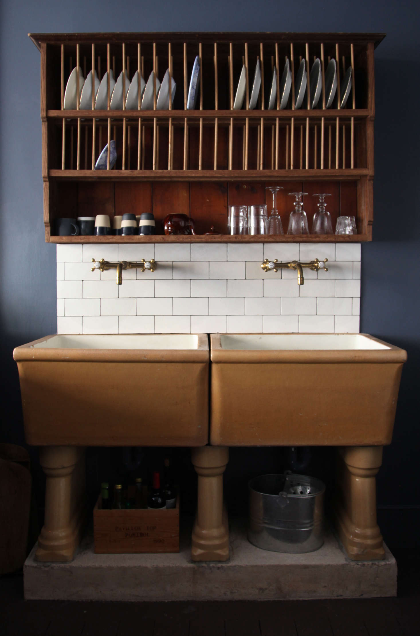 The sink has Barber Wilsons brass faucets—Berdoulat is launching a range of taps with the company in a few months—and a backsplash of reclaimed subway tiles bought on eBay. The plate-drying rack is a prototype for one that will be sold in the Berdoulat shop along with other &#8