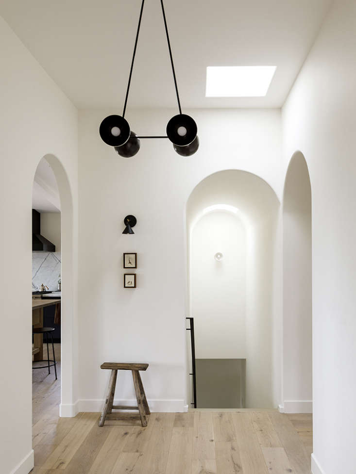 a hallway in a a serene, well balanced house for a violinist and a physician, i 16