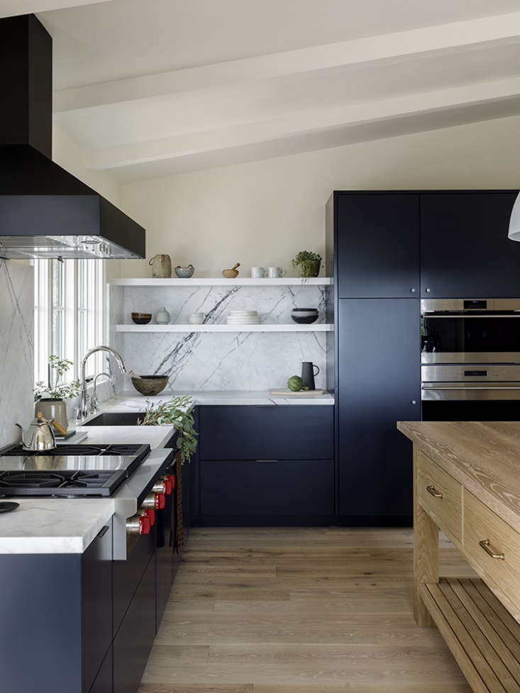 Cabinets are fitted with clean-lined, unobtrusive hardware from Top Knobs.