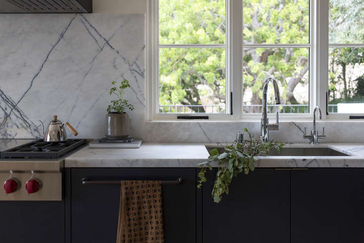 A generous backsplash continues above the counter. (For a similar look, see  Favorite Marble Kitchen Backsplashes, for Maximum Drama.)