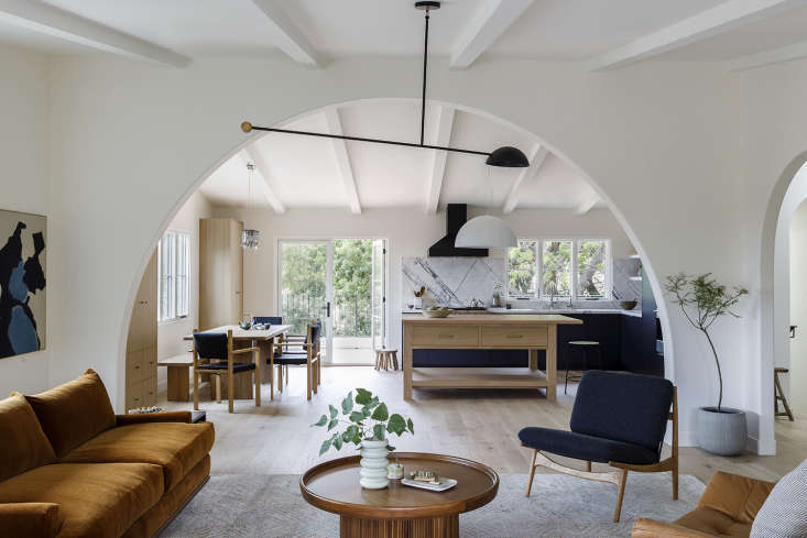through a wide archway, into the kitchen. the black pendant is the astro dome l 11