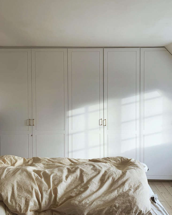 A wall of closets beside the bed, for plenty of storage.