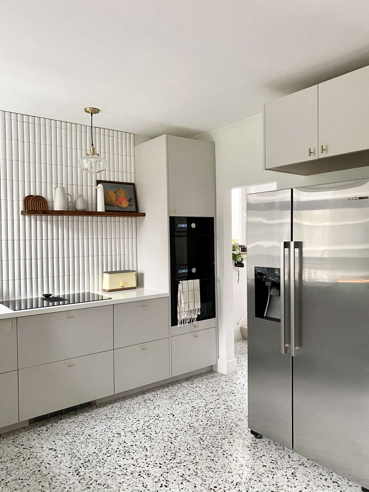 The fridge, a Bosch, is now centrally located. The &#8