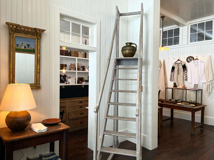 To ready the space for the shop, Kostas divided it into front and back sections. The ladder came out of the library of an old house in Bondues, in northern France. The transom windows were found in the building&#8