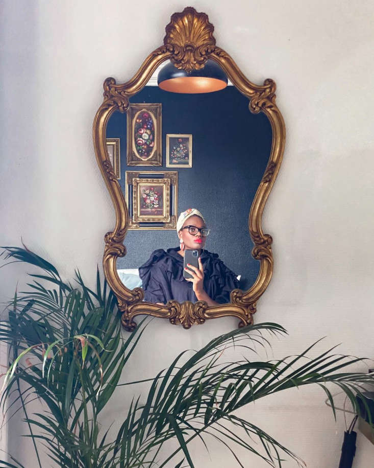 Ajiri in an antique gilded mirror she found, via her Instagram, @ajiriaki.