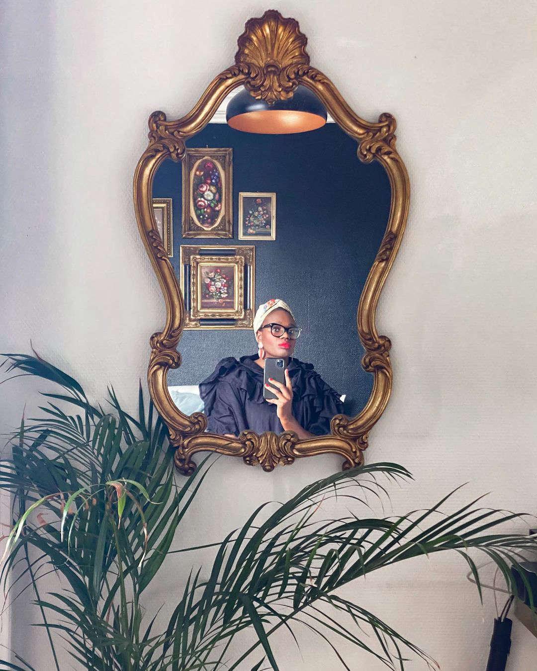 Ajiri in an antique gilded mirror she found, via her Instagram (@ajiriaki).