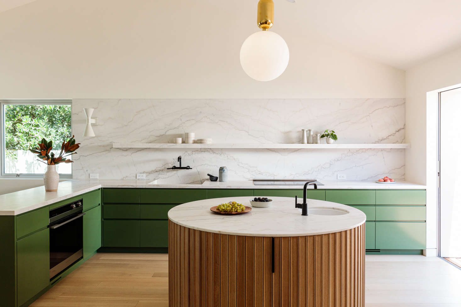 """A sunny Los Angeles kitchen by And And And Studio features a suite of Contemporary-style appliances: a 36"""" Five-Zone Induction Cooktop, Integrated Double DishDrawer Dishwasher; 30"""" Wall Oven, and 36"""" Integrated Refrigerator Freezer. Photograph by The Ingalls."""