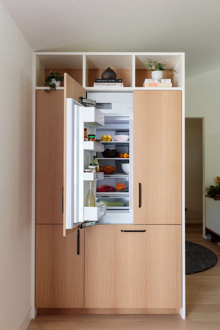 """The 36"""" Integrated French Door Refrigerator Freezer in the LA kitchen, fitted with panels. The fridge has ActiveSmart technology that learns how you use your fridge—and adjusts airflow, temperature, and humidity to keep everything fresher longer."""
