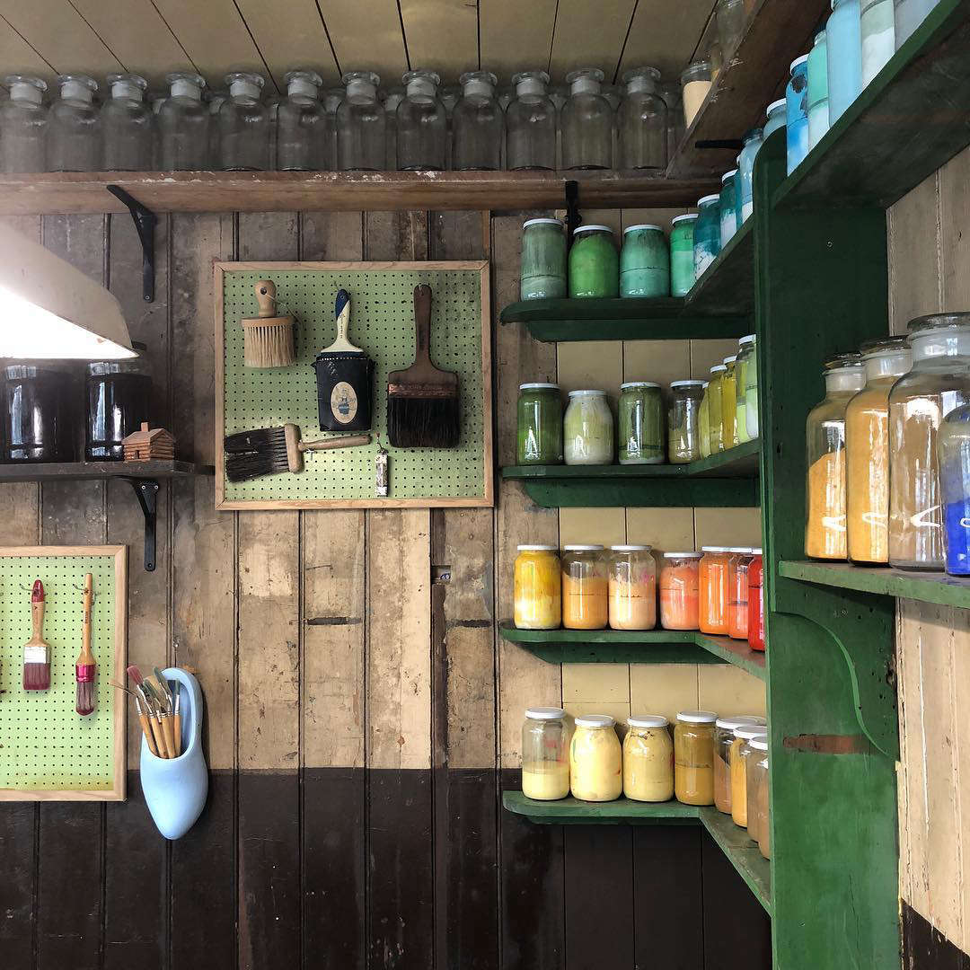 Pigments line the walls of the shop, ready for experimentation.