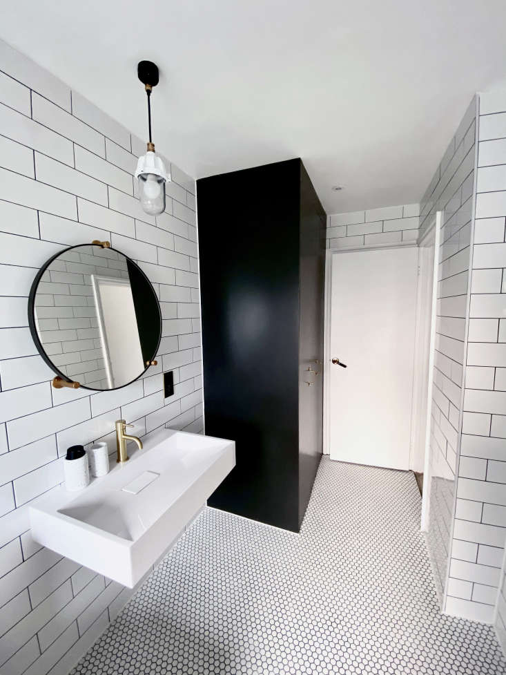 Bathroom of the Week Ferren Gipson Upgrades Her London Loo and Makes Room for the Laundry Thanks to the convenient cupboard, Ferren says, most days she and her family manage to keep the surfaces clear of stuff. The Industrial Outdoor/Bathroom Light is from Urban Cottage Industries.