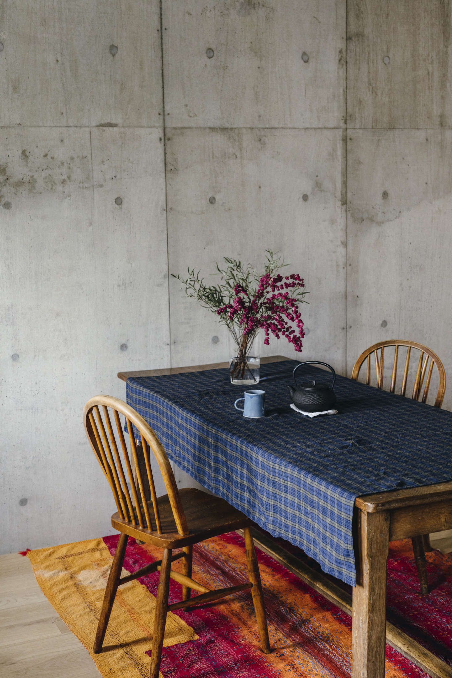 An early trip to Lithuania inspired Yumiko to produce linen for the home; shown here, a table draped in a check patterned cloth of her design in her Tokyo house.