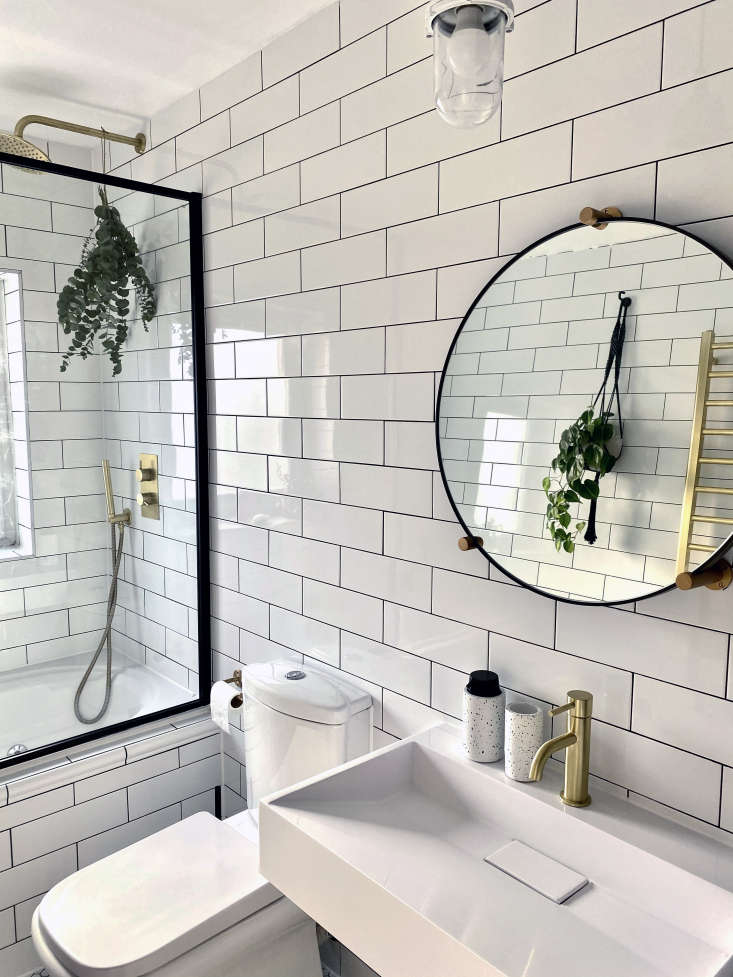 The existing sink turned out to be cracked, so it was replaced with a Rectangular Wall-Mounted Stone-Resin Basin and Brushed Brass Mixer Tap, both by Arezzo from Victorian Plumbing. The mirror is the Jamison by Made.