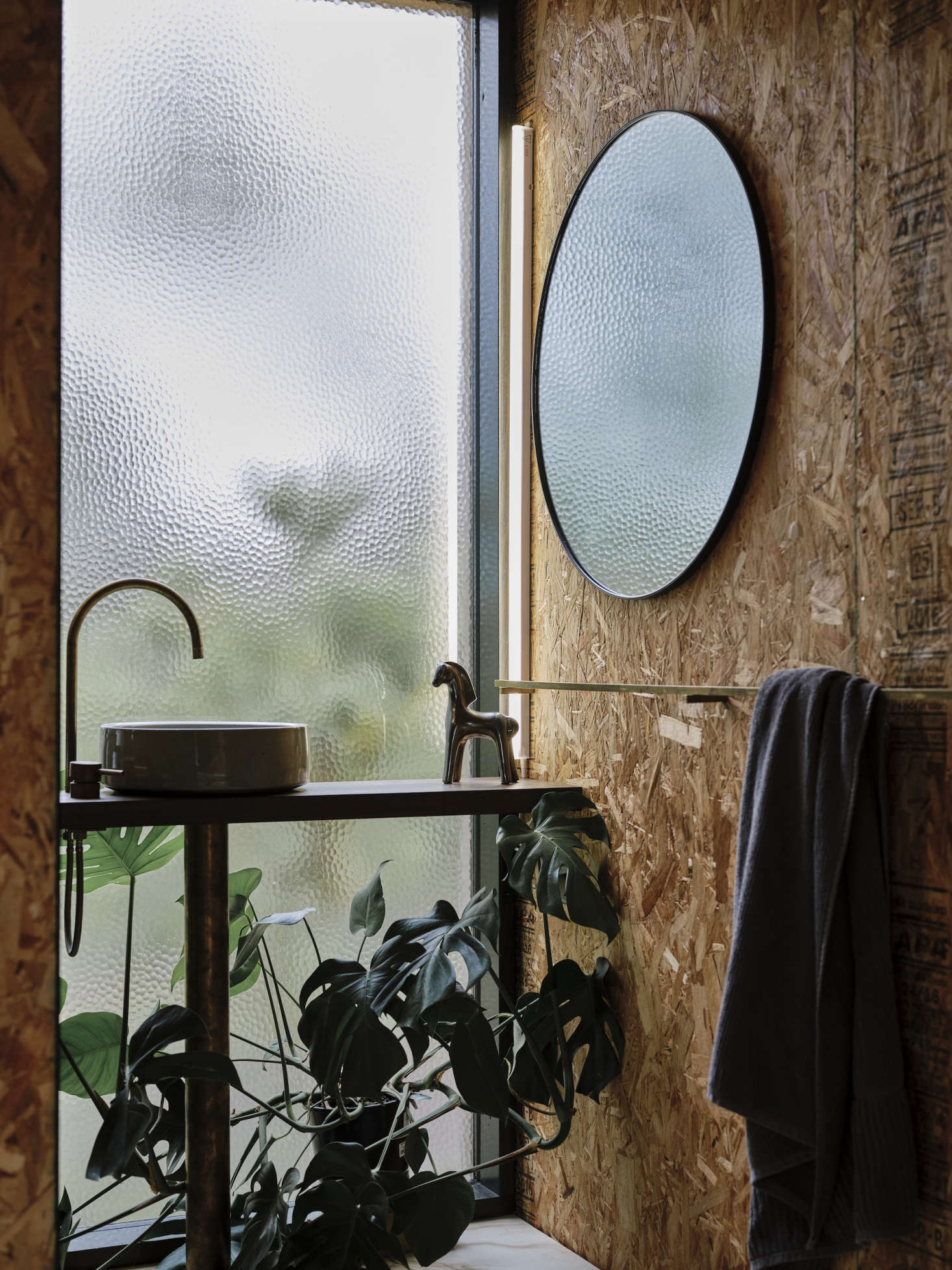 Textured glass allows privacy in the bathroom. The bathroom sink is by local ceramicist Lindsey Wherrett.