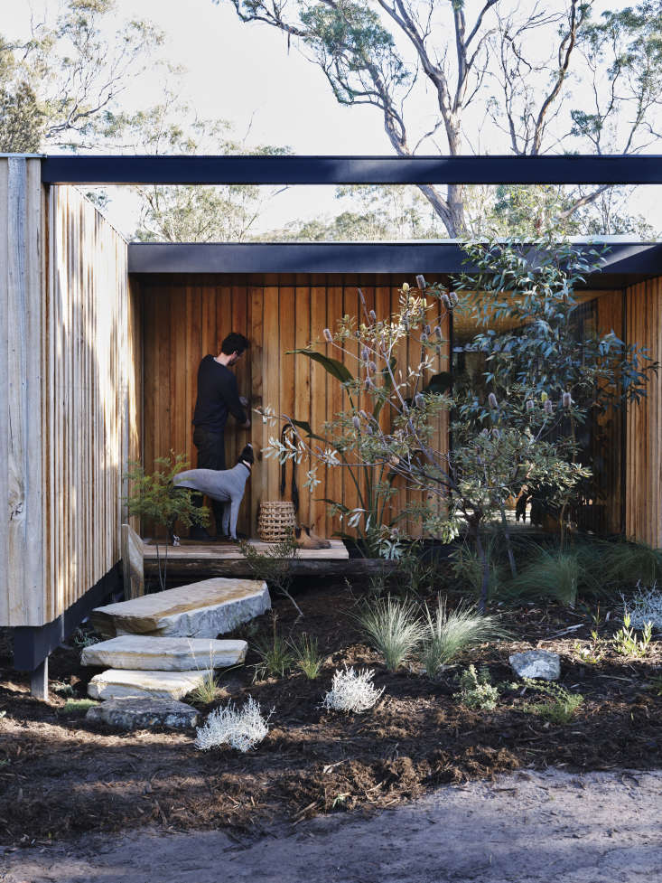 Josh and Millie built their small moveable home in the bushland, on property owned by her parents. Both the landscaping and architecture are meant to blend into the natural environment. &#8