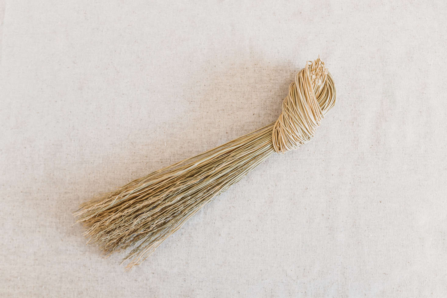 I particularly love the small, simple Knot Broom ($8), with a handle of tied broomcorn.