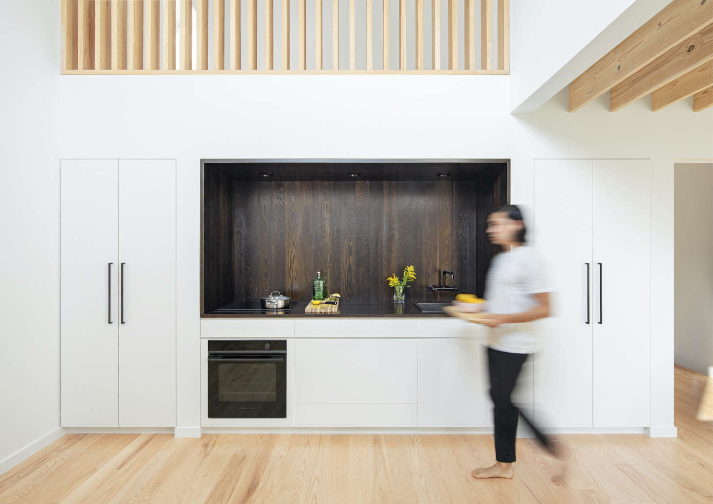 """A fleet of now-you-see-them, now-you-don't Integrated appliances are the perfect fit for a small-space kitchen by architect Landon Brown, including an Integrated CoolDrawer Multi-Temperature Drawer, a """" Integrated Wall Oven, and a """" Four-Zone Induction Cooktop. Photograph by Mark Wickens."""