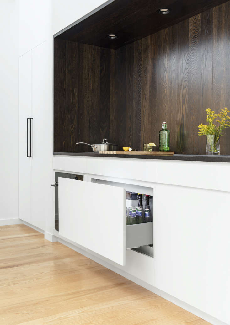 The Integrated CoolDrawer Multi-Temperature Drawer in situ. The drawer's temperature can be changed at the push of a button, so that it can be used as refrigerator, freezer, pantry, chiller, or wine storage—and it's fronted here with a custom panel, so it cleverly blends into the cabinets when closed. Photograph by Mark Wickens.