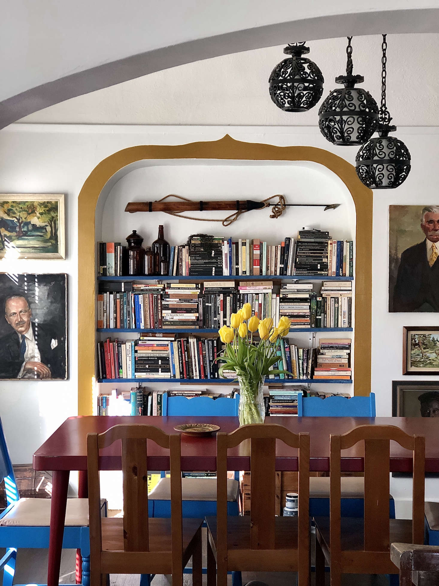 In the dining room, Gillian framed the inset wall shelves with a ribbon of paint (Behr&#8