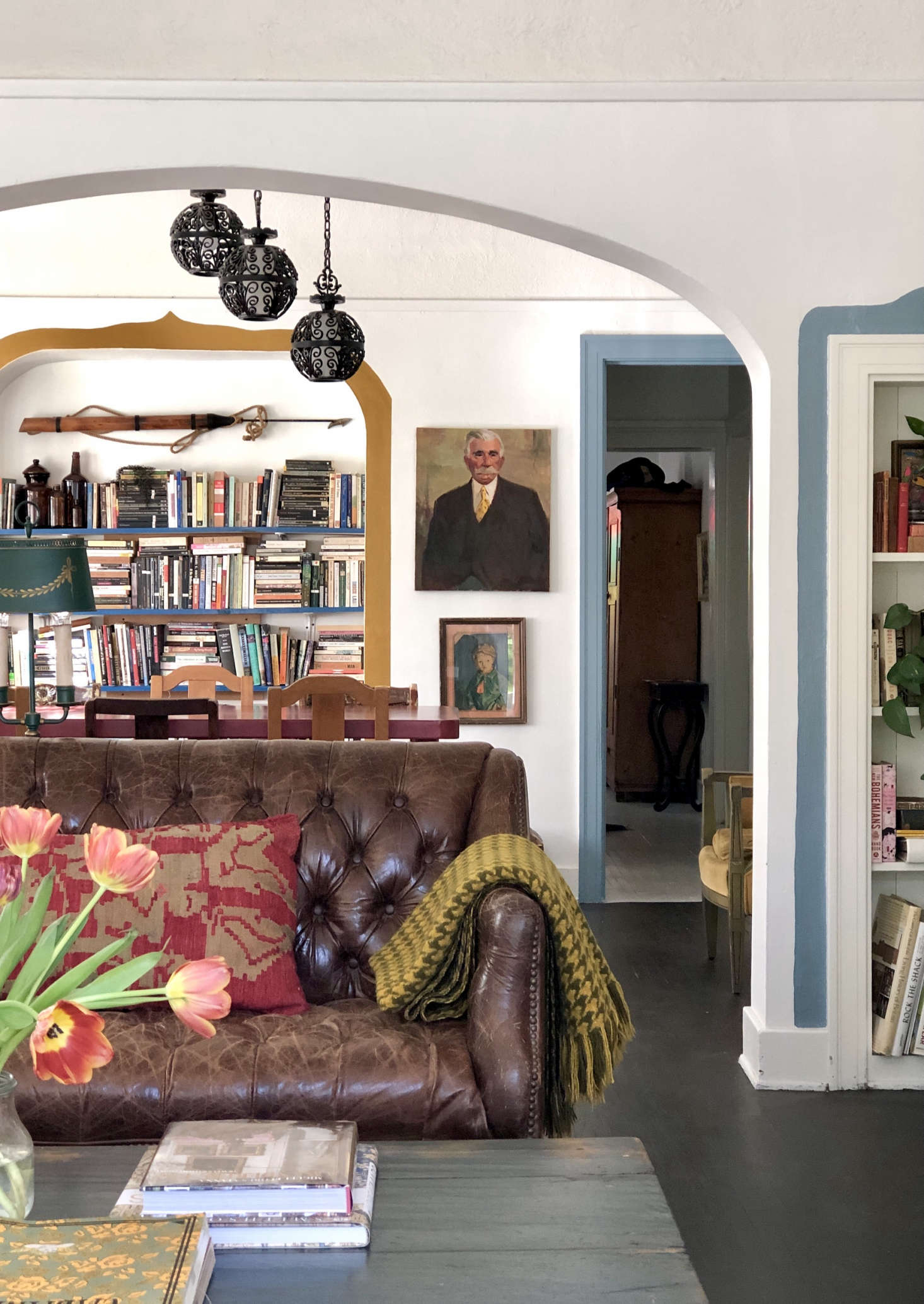 The doorway trim in the dining area echoes the book-case frame in the living room; both are painted in Behr&#8