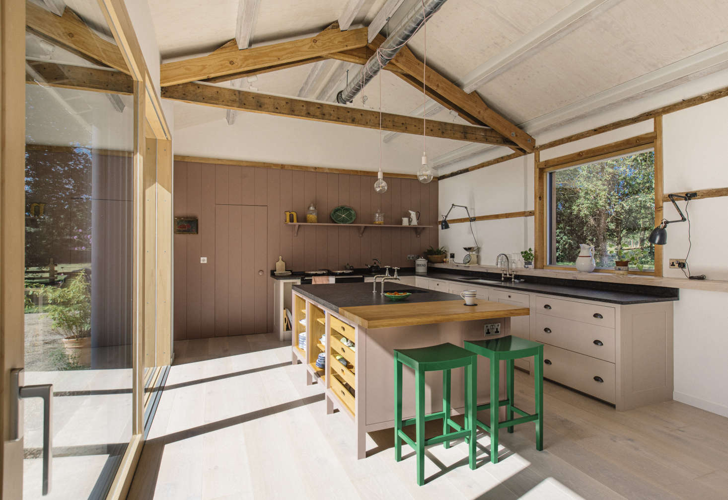 The tongue-and-groove paneled back wall and door opens to a pantry that&#8