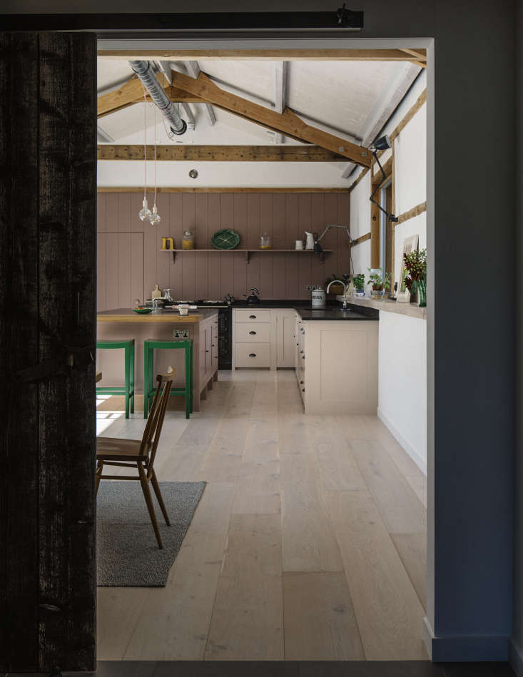An adjoining vestibule links the kitchen to the 300-year-old main barn that houses the sitting room and bedrooms. The limed-oak wide floorboards—sourced affordably from a local warehouse store after first-choice Dinesen proved too pricy—have under-floor heating. The white walls are lime plaster.
