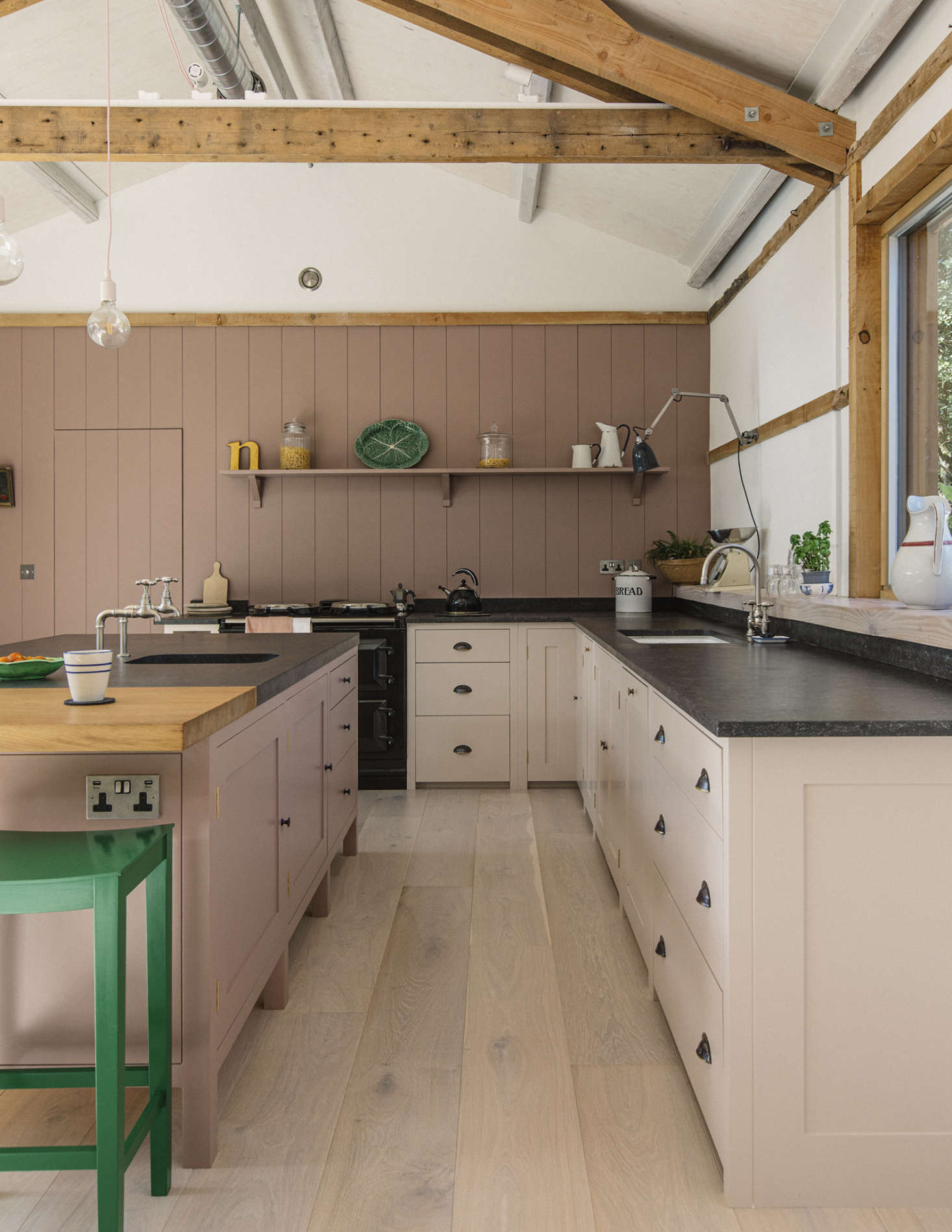 The kitchen cabinets are made of poplar with oak veneered interiors and solid oak dovetailed drawers. The counters are blue-black Belgian fossil stone with an &#8