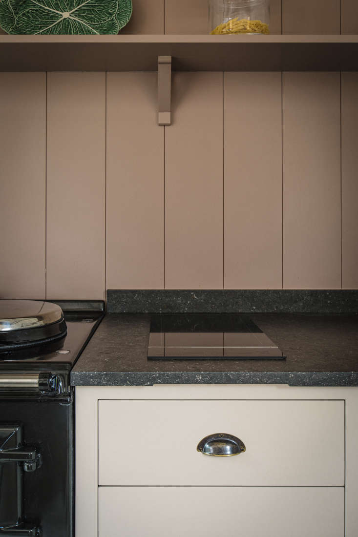 The Fisher & Paykel induction cooktop is big enough for two pans. The Aga has an internal vent for the ovens—the pipe goes to an external wall in the pantry—and there&#8