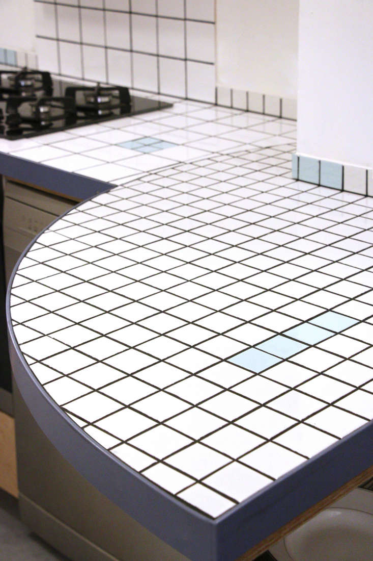 Kitchen of the Week An Inventive BudgetConscious Kitchen Built from Leftover Tile &#8\2\20;The grid is the leitmotif that keeps everything together,&#8\2\2\1; says Deborah. The flared counter provides extra work space and a place to set up a bar or buffet. The four burner cooktop is by Boulanger.