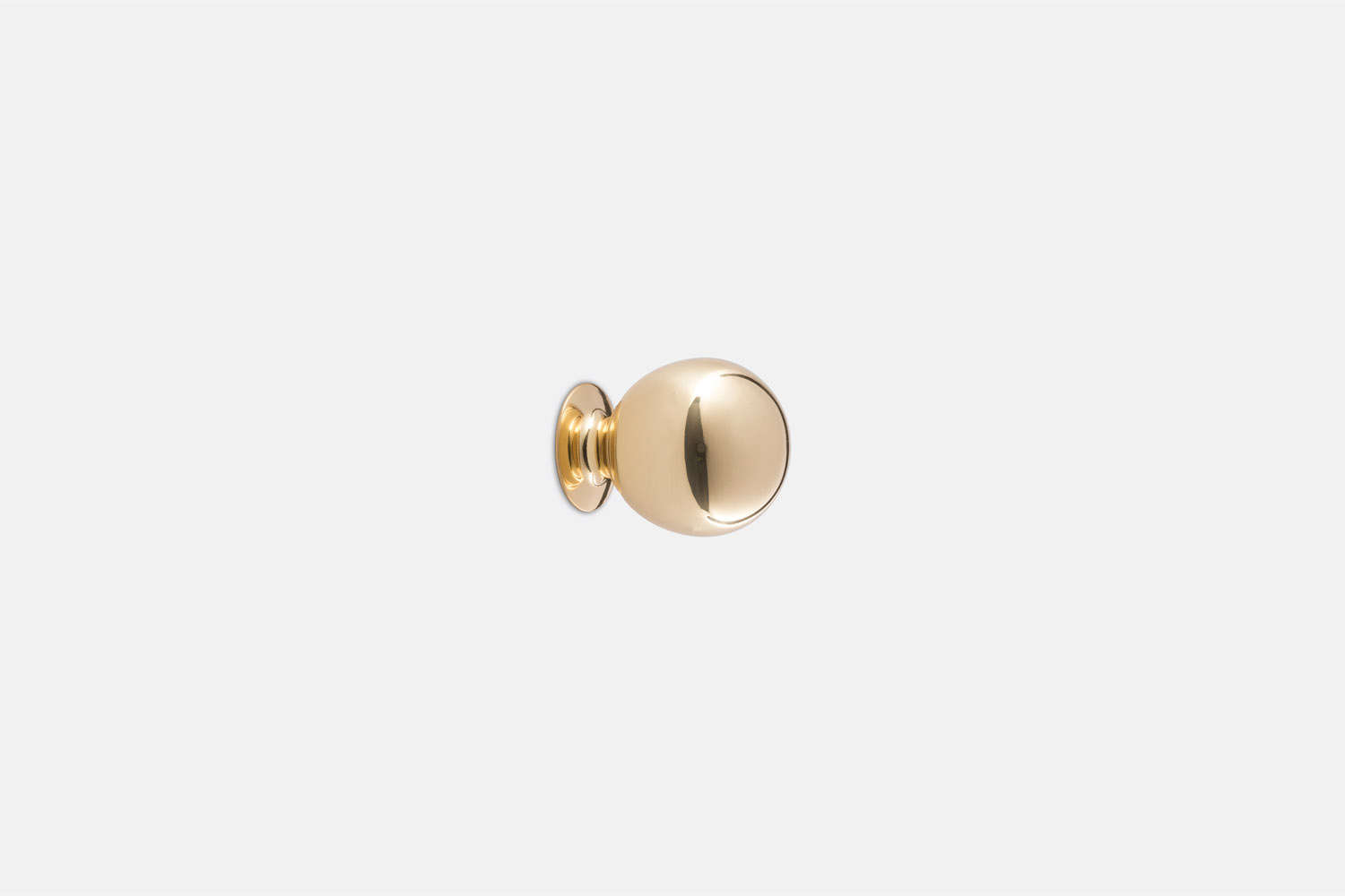 The Ball Cabinet Knob in unlacquered brass is $loading=