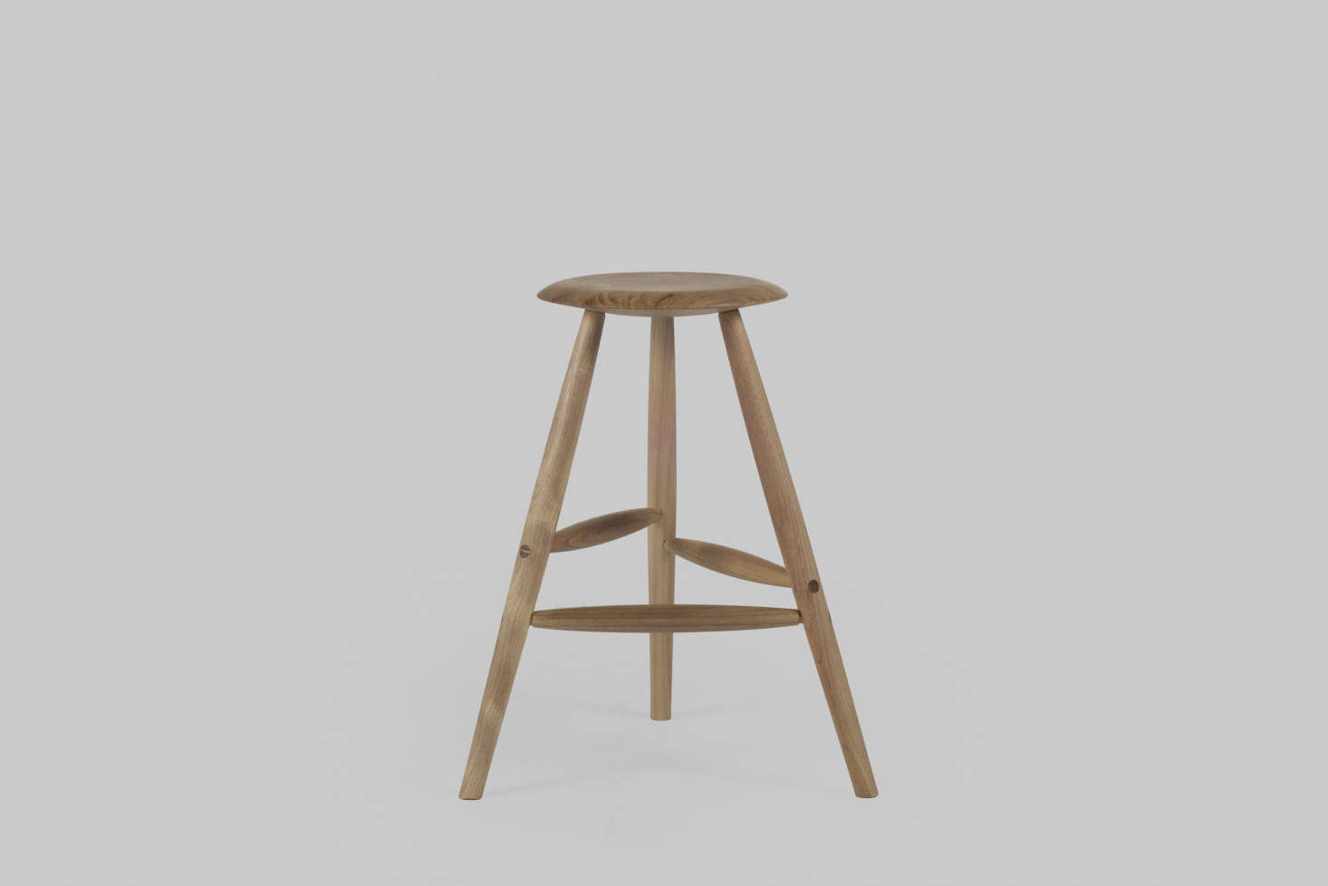 The winner will be able to customize their stool from the selection of woods and finishes; this is the stool in bleached walnut.