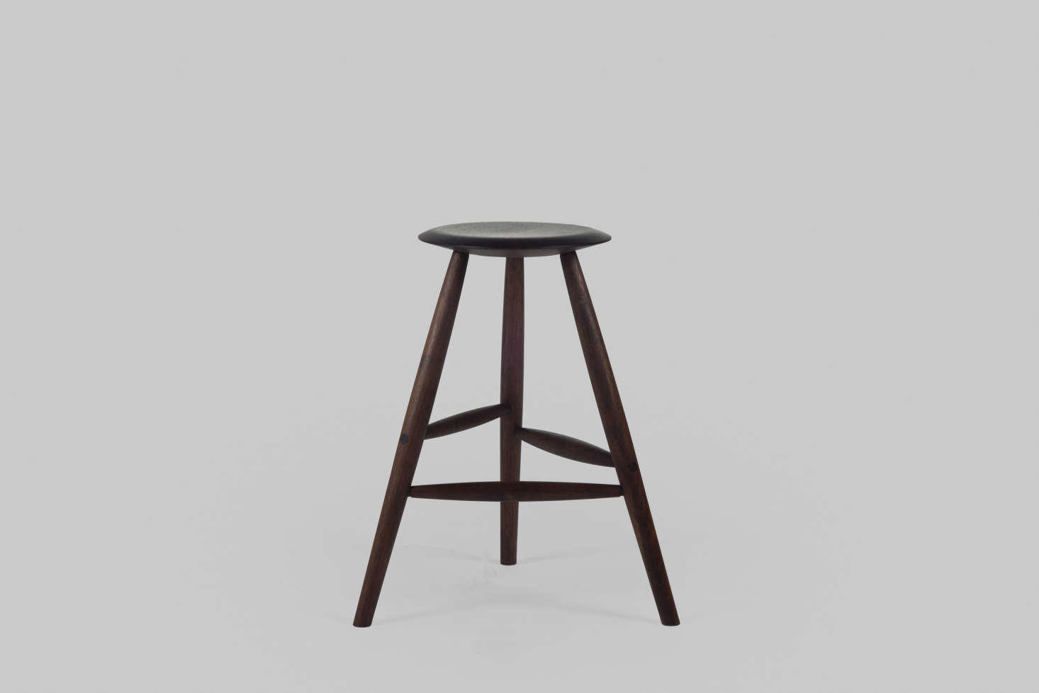 The stool's stature makes it versatile for all over the house—as a side table or even a nightstand. Shown here is the stool in oiled American black walnut.