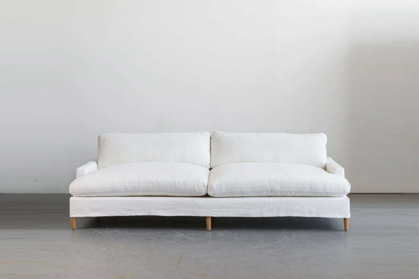 From Shoppe by Amber Interiors, the Bille Slipcover Sofa starts at $5,900.