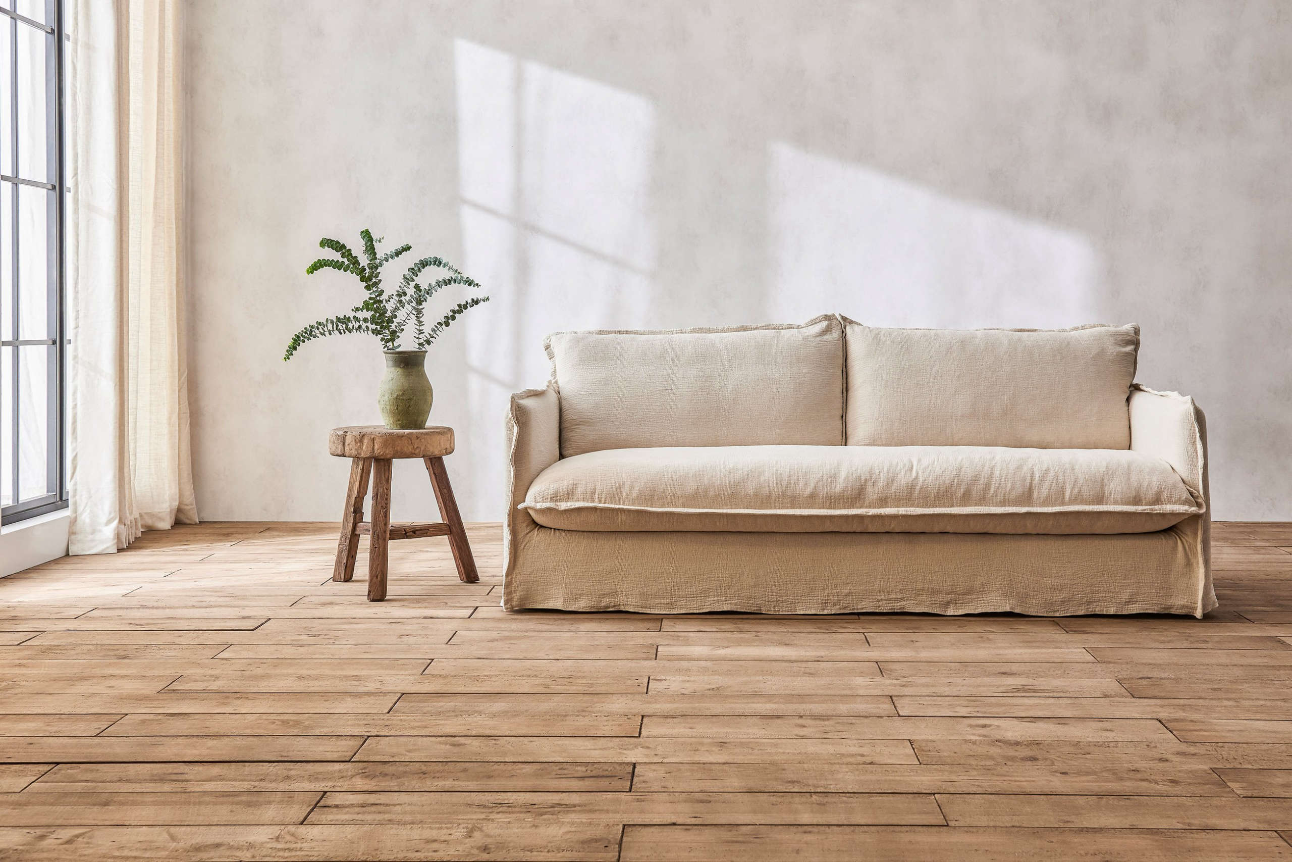 The Neva Sofa from Six Penny is available in white cotton is $