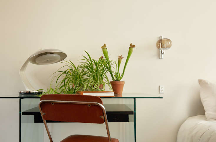A Room of Ones Own An En Suite Retreat in Paris The father&#8\2\17;s glass desk is a hand me down from friends. He bought the lamp at &#8\2\20;a bric a brac in Normandy.&#8\2\2\1; Because space is tight, the folding desk chair doubles as bedside table.