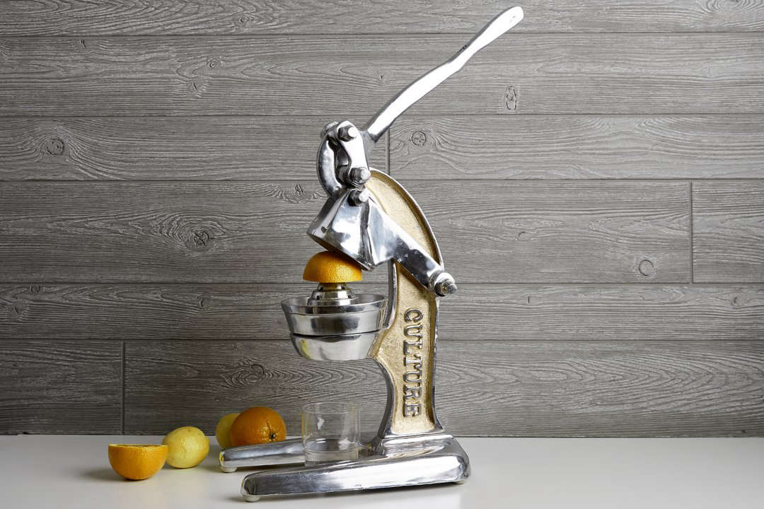 The large Verve Artisan Citrus Juicer is  inches high and is available with rose gold or gold trim; $0 from Verve Original.