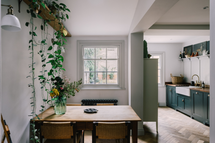 The kitchen is small but has space for a dining table. Just beyond the kitchen is a small patio.