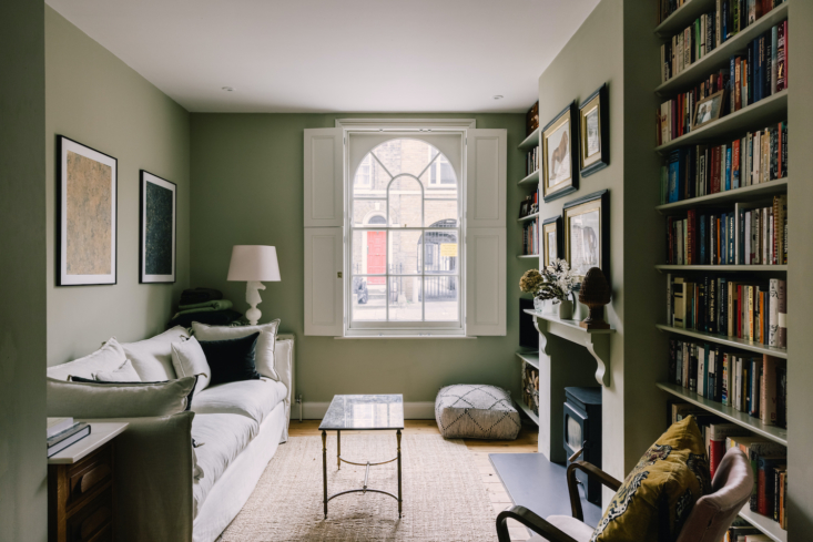 Jen and Jack Pelzig share the 950-square-foot two-bedroom house with their toddler son. An arched window in the living room looks out onto the street.