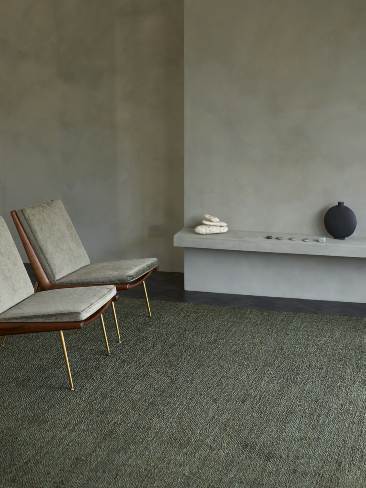 "The Terra rug is made from hand-spun jute, pictured here in Moss. Appropriately named, this everyday rug is ""reminiscent of the grounding sensation one feels when traversing a path of sand, grass, and soil.&#8"