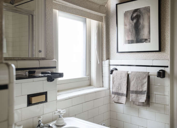 In another bathroom: more original fittings, including tile, faucet, inset soap dish, and ceramic and glass towel bars.