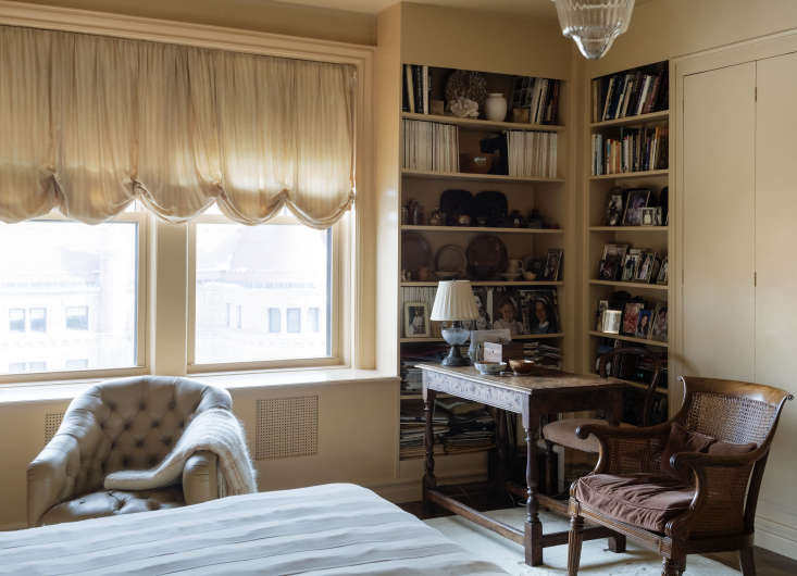 Doris designed corner bookshelves in her bedroom, to display a collection of her favorite family photos.