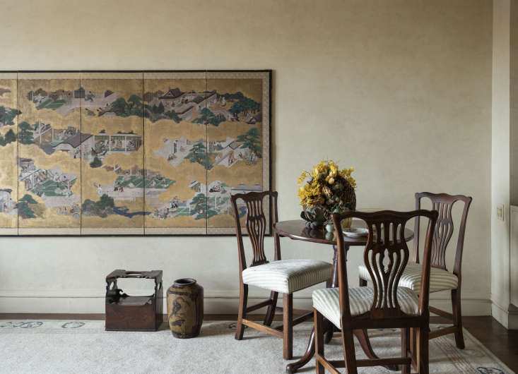 In a corner of the living room is an antique Japanese screen Doris bought at a local auction. &#8