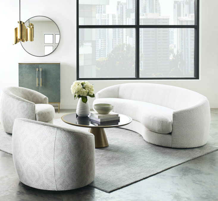 Create a conversation area with the new Giselle Sofa and Swivel Chairs. Curved for comfort, they each offer a supportive upright back and generous seat cushion. The sofa is seen here in a soft textured boucle; on the swivels is a tonal print from the company's exclusive collection of designer-favorite Kravet fabrics. Both can also be customized in hundreds of fabrics and leathers.