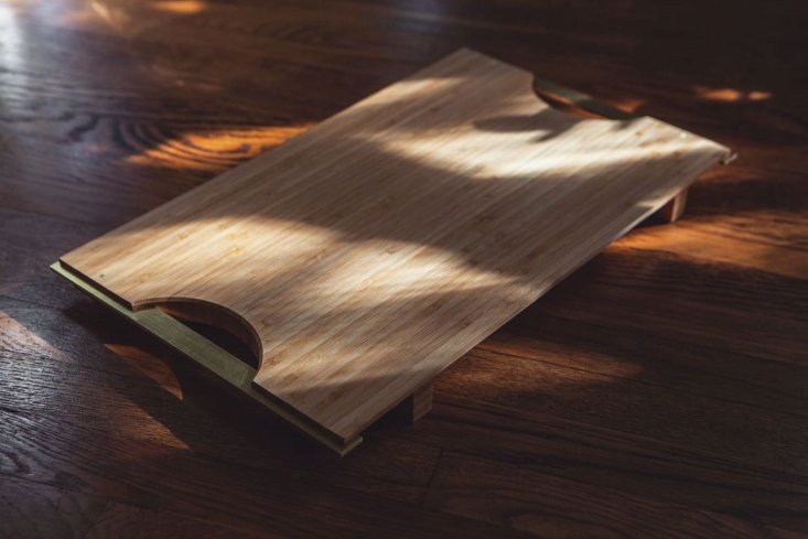 the brass and bamboo trays come in two sizes; \$\1\20 and \$\140. 17