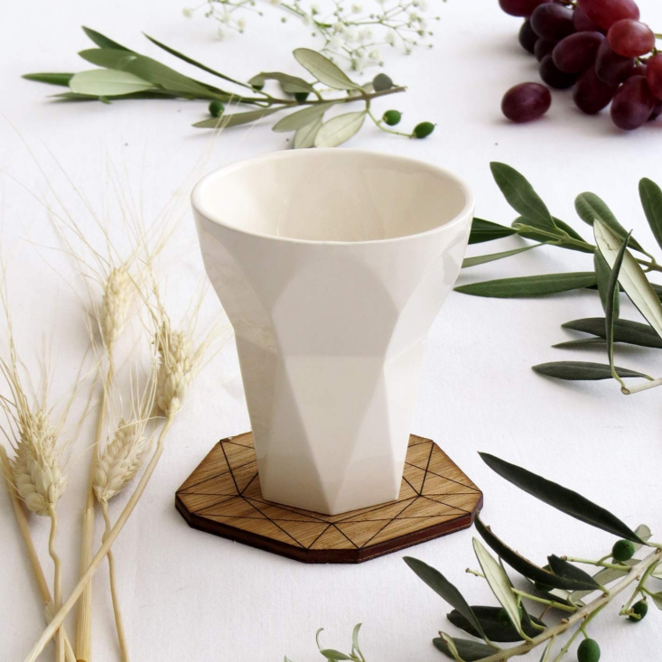 Object of Desire The Contemporary Kiddush Cup for the Passover Table A faceted Ceramic Kiddush Cup with a wooden coaster is \$89 from Armadillo Judaica Lovers via Amazon.