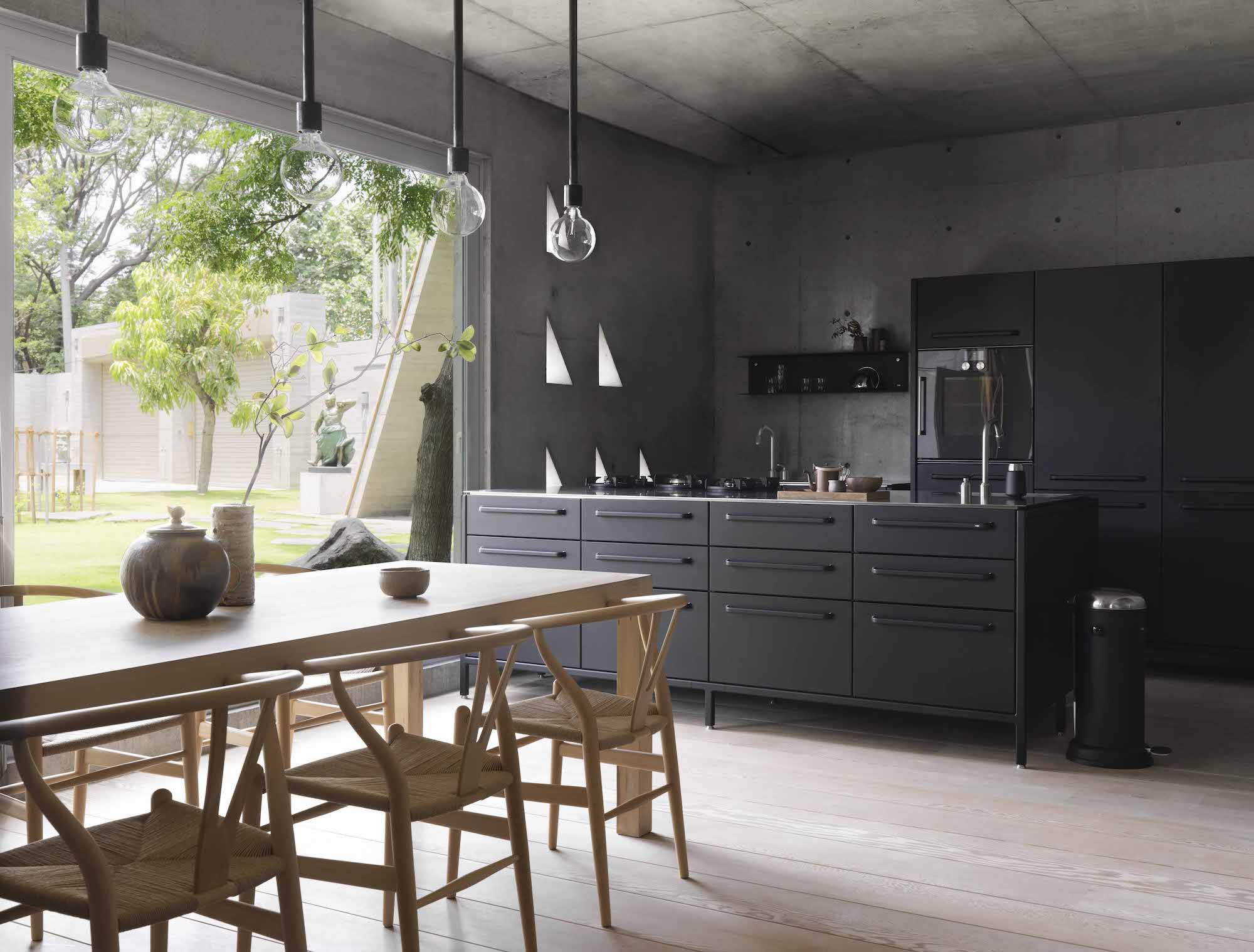 The combined dining and kitchen space occupies the ground floor, with open access to the garden. When he started planning the kitchen area, Chiang was pleased to discover the Vipp Kitchen src=