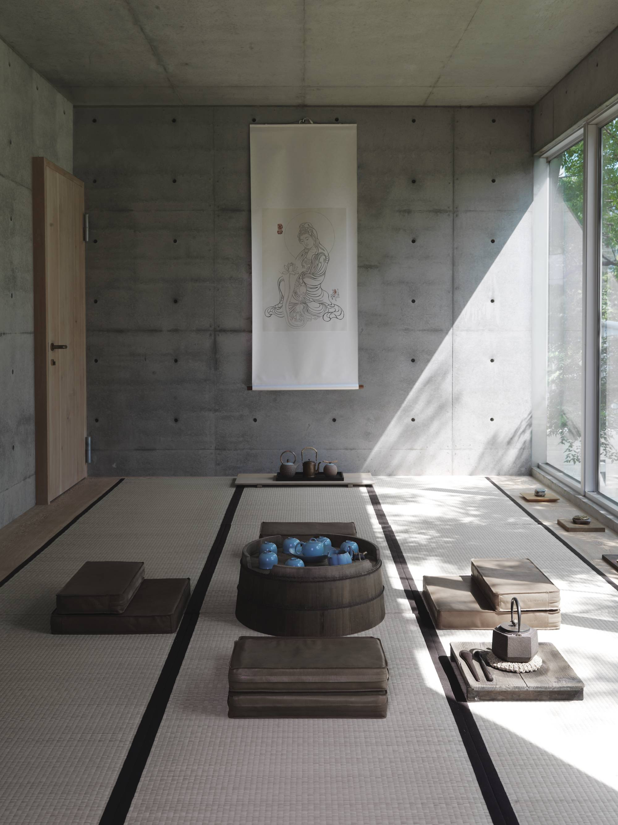 A guest room and a tea ceremonial room/prayer room face the forest.