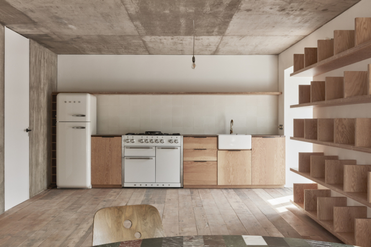 """The custom-made kitchen. """"They wanted to give me cupboards, but I said just give me a shelf for artwork."""""""
