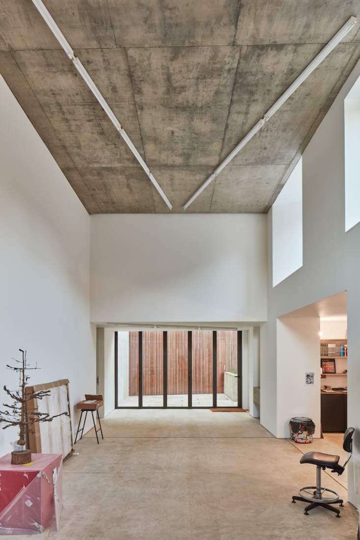 In the main space, a white wall reaches nearly five meters ( feet) to the ceiling, which is lit by a zigzag of fluorescent strip lights. Noble and Webster&#8